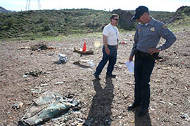 Marty Fabritz, right, shooting sports branch chief at the Arizona Game and Fish Department, and Tom Bickauskas, a natural resource specialist with the Bureau of Land Management, survey a landscape marred by trigger trash in Table Mesa Recreation Area.