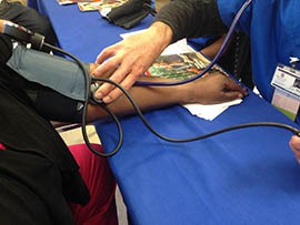 Phoenix Baptist Hospital offered free blood pressure checks Friday as part of a Go Red event calling attention to the dangers and symptoms of stroke, heart disease and diabetes.