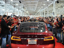 A Tesla drives down the red carpet at the company's factory in Fremont, California, in June 2002.