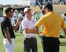 Arizona State junior golfer and Waste Management Phoenix Open participant Jon Rahm, right, talks with caddie and ASU teammate Ben Shur, center, and coach Tim Mickelson on the driving range.