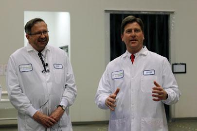 Deputy U.S. Secretary of Commerce Bruce Andrews (left) and Phoenix Mayor Greg Stanton toured APS BioGroup on Thursday.