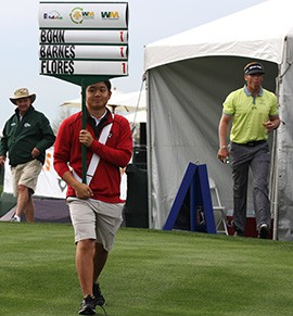 Truman Park a sophomore golfer from Hamilton High School holds the standard proudly as he walks off of the first tee at the Waste Management Phoenix Open.