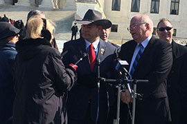 Arizona House Speaker David Gowan, in hat, and former Speaker Andy Tobin answer questions outside the Supreme Court, where lawmakers argued that hte state's redistricting commission is unconstitutional.