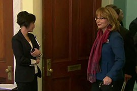 Former Rep. Gabrielle Giffords, right, makes her way to a lectern to urge Congress to act to approve gun-control measures. Giffords, wounded in a 2011 attack, spoke slowly but forcefully at the event. Cronkite News' <b>Nihal Krishan</b> has the story.