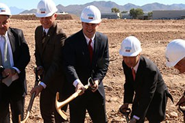 Gov. Doug Ducey, pictured here at a Special Devices Inc. expansion groundbreaking in Mesa on March 16, says he's proud of the budget he signed last week that includes $99 million in cuts to universities.