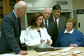 Vice President Joe Biden, left, listens with Maryland Rep. Dutch Ruppersberger and Sens. Ben Cardin and Barbara Mikulski as a forensic technician explains the process of DNA testing of a rape kit.