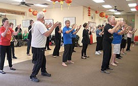 Participants in a class offered by Scottsdale Taoist Tai Chi Center.