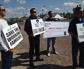 """Protesting a """"flex loan"""" measure introduced at the state Legislature are, from left, Bill Cusimano, 56; Anthony Ruelas, 34; Luis Schmidt, 40; and Marshall Pimentel, 47."""