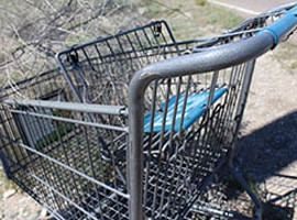 A discarded shopping cart near Ehrenberg illustrates the problem of desert dumping in La Paz County.