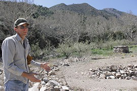 At Beatty's Guest Ranch outside Sierra Vista, Tom Beatty Jr. shows areas damaged by the fire and the floods and landslides that followed.