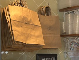 Flower Child, a restaurant in Phoenix, uses recycled materials in its paper bags and to-go containers.
