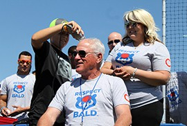 Chicago Cubs manager Joe Maddon and his players shaved their heads for Maddon's Respect Bald fundraiser to benefit pediatric cancer research and care.