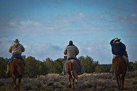Riders in the New Lands, part of the Navajo Nation where Navajo families have been relocated after being moved off what became Hopi lands/