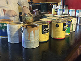 A technician reviews paint turned in to Gilbert's Household Hazardous Waste Facility.