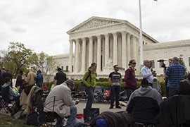 People camp out on the sidewalk Monday, a day before the Supreme Court is set to hear arguments on same-sex marriage.