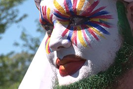 The colorful protest included singing, praying and sign-waving by middle schoolers, people in costume and makeup.