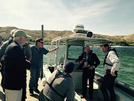 After joining state and federal officials Friday to formalize an agreement to reopen the damaged Willow Beach National Fish Hatchery near Hoover Dam, U.S. Sen. John McCain, at left, took a boat ride on the Colorado River.