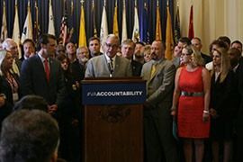 Rep. Jeff Miller, R-Fla, and Rep. Kyrsten Sinema, D-Phoenix are flanked by dozens of advocates as they call for new accountability at the Department of Veterans Affairs.