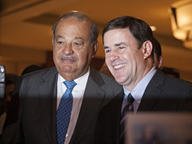 Business tycoon Carlos Slim Helu says he supports Gov. Doug Ducey and predicts relationships between Arizona and Mexico will improve.
