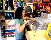 Amanda Casey, an employee at Record Revival in central Phoenix, flips through vinyl LPs.