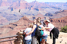 Tourists pose for a selfie in Grand Canyon National Park.